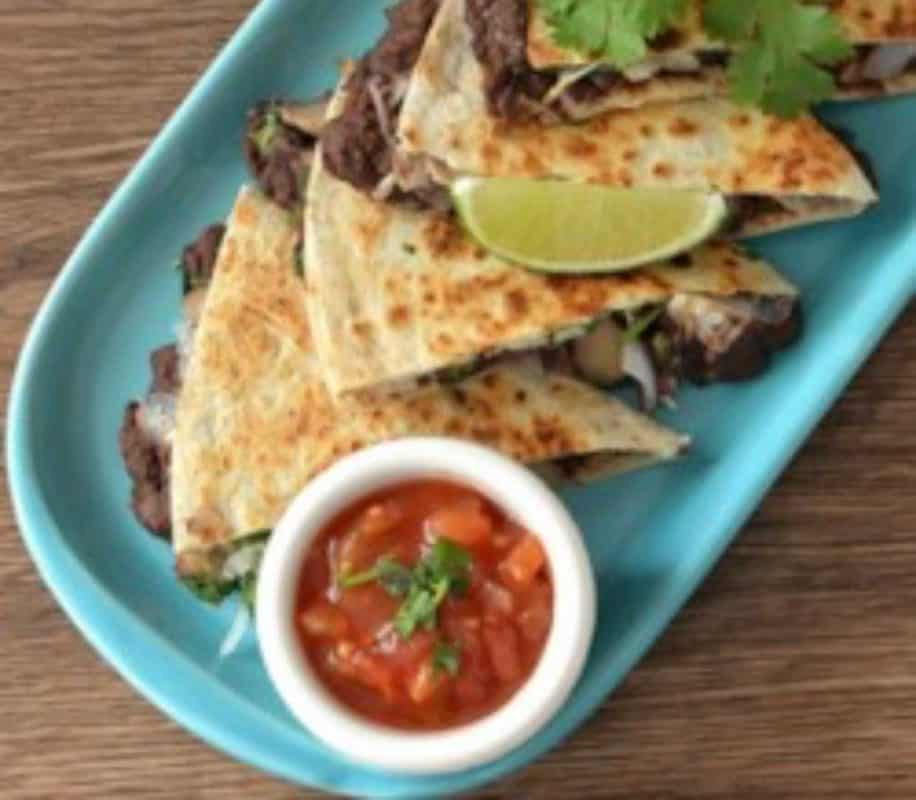Quesadilla with char-grilled pepper, mushrooms and re-fried beans